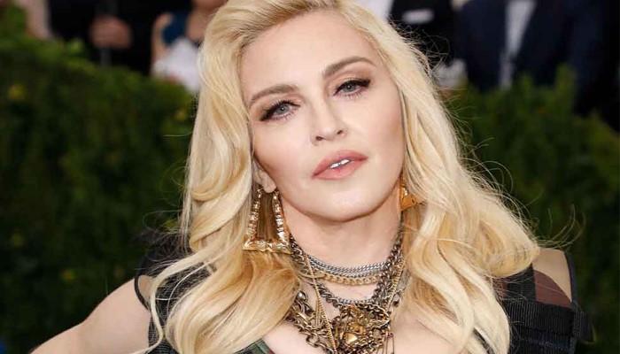 Мадонна - певица и бизнесмен